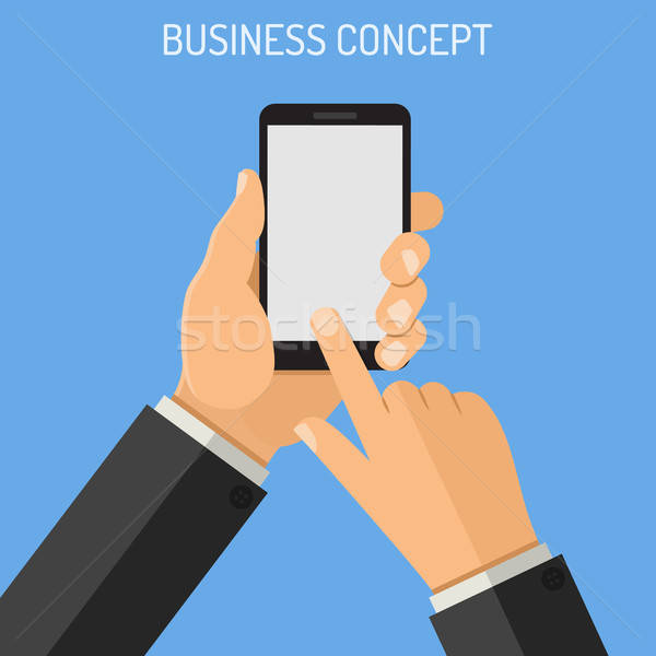 Man holding smartphone in hand Stock photo © -TAlex-