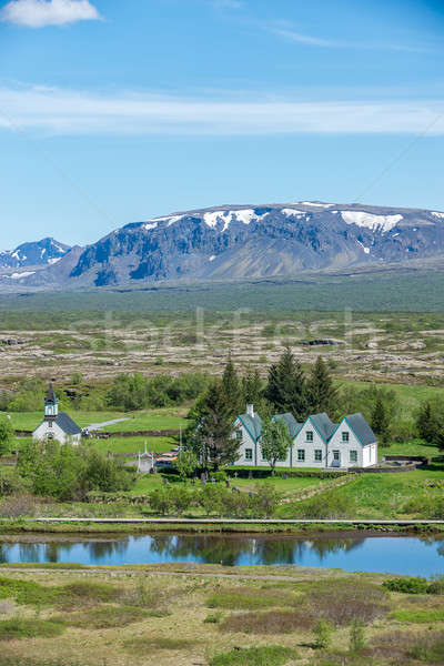 Scenic view of famous Thingvellir with white church, Iceland. Stock photo © 1Tomm