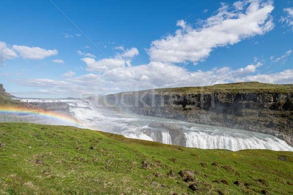 Gouden waterval regenboog IJsland water wolken Stockfoto © 1Tomm