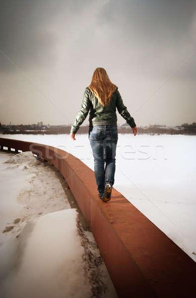 woman going on parapet Stock photo © 26kot