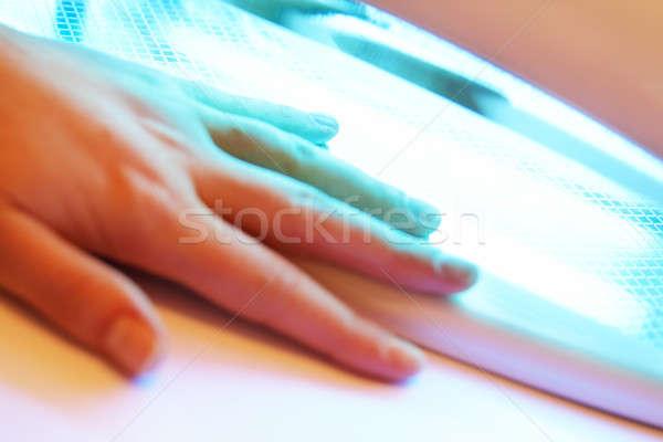 Manikür kadın eller uv lamba plastik Stok fotoğraf © 26kot