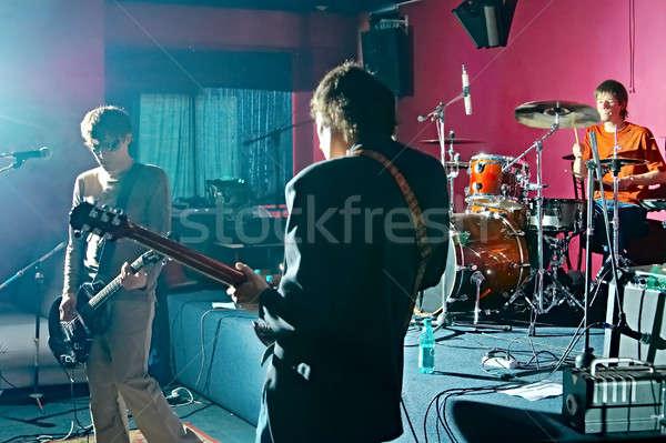 Stok fotoğraf: üç · müzik · parti · adam · mikrofon · grup