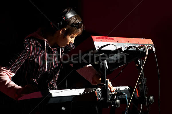 girl playing on synthesizer Stock photo © 26kot