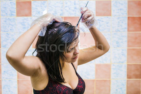 woman dyeing hairs Stock photo © 26kot