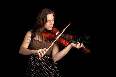 Stock photo: violinist isolated on black background