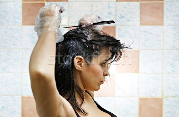 woman dyeing hairs Stock photo © 26kot