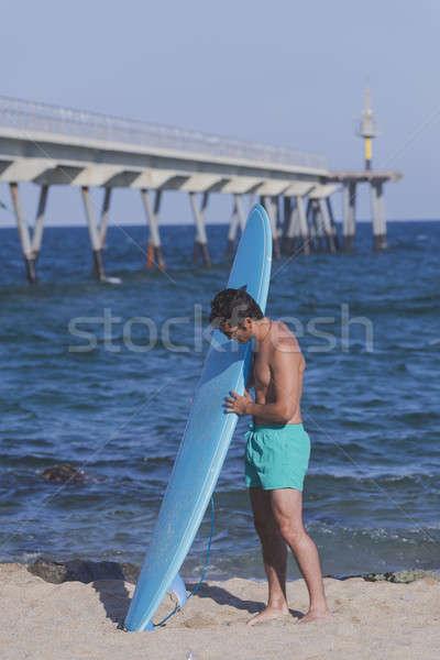 Surfista azul prancha de surfe praia céu Foto stock © 2Design