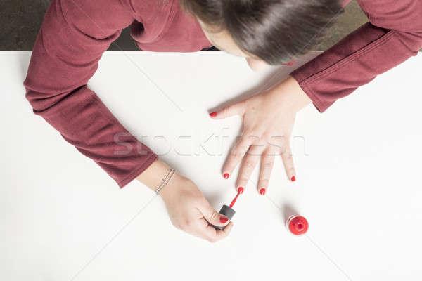 Kadın boyama çivi kırmızı üzerinde görmek Stok fotoğraf © 2Design