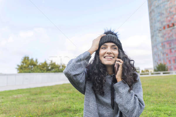 Woman calling on phone sitting on the grass Stock photo © 2Design