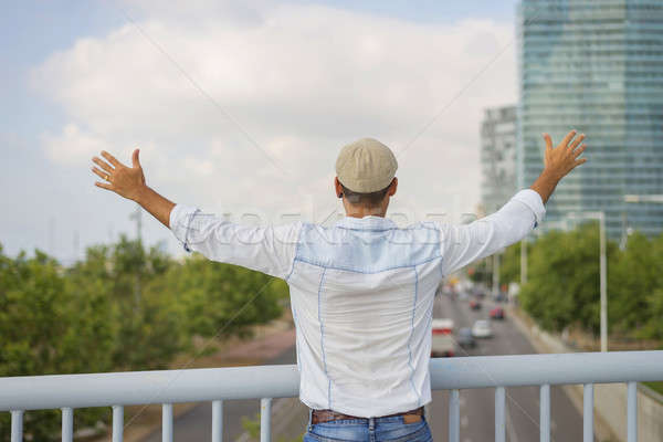 Man with hat standing and looking the skyline of the city. Stock photo © 2Design