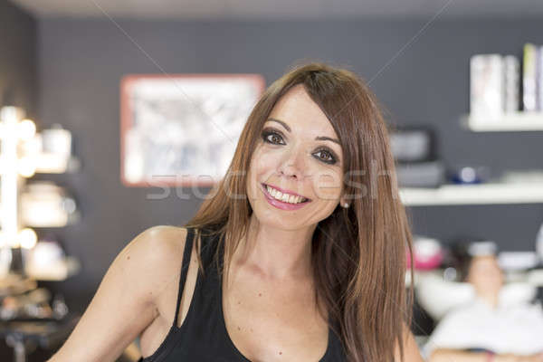 Portrait of a young and pretty hairdresser Stock photo © 2Design