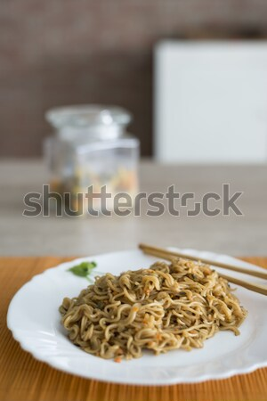 Noodles with beef in plate with bamboo stic Stock photo © 2Design