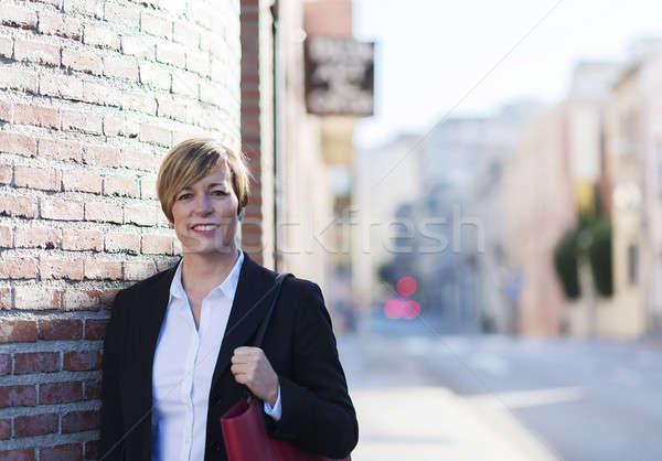 Outdoor portrait of a beautiful lady on the street wearing forma Stock photo © 2Design
