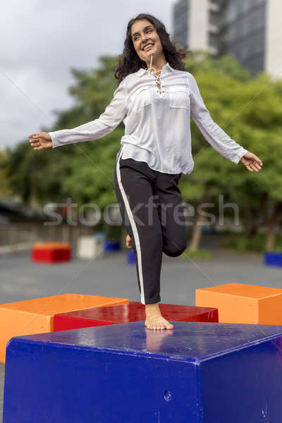 Young handsome black hair woman jumping outdoor Stock photo © 2Design