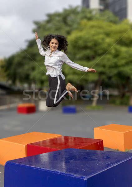 Jóvenes guapo pelo negro mujer saltar aire libre Foto stock © 2Design