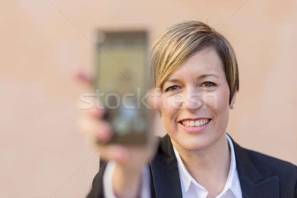 Mulher telefone móvel turva negócio Foto stock © 2Design