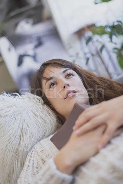 Stock fotó: Fáradt · fiatal · nő · kanapé · könyv · nők · újság