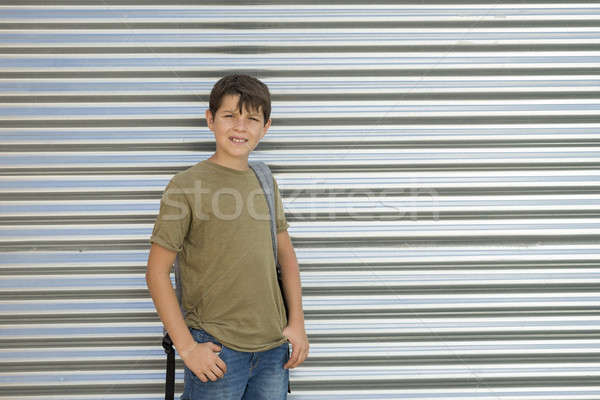 Cheerful child carrying his backpack Stock photo © 2Design