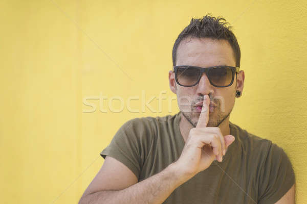 Close up shot of handsome male with shhh gesture Stock photo © 2Design