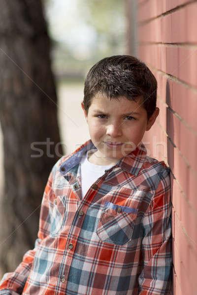 Retrato casual adolescente menino ao ar livre primavera Foto stock © 2Design