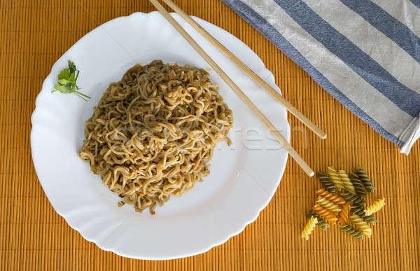 Tészta marhahús téglalap tányér bambusz asztal Stock fotó © 2Design