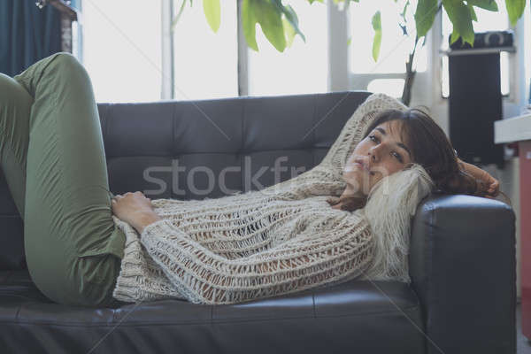 Portrait of a young woman sleeping on a sofa Stock photo © 2Design