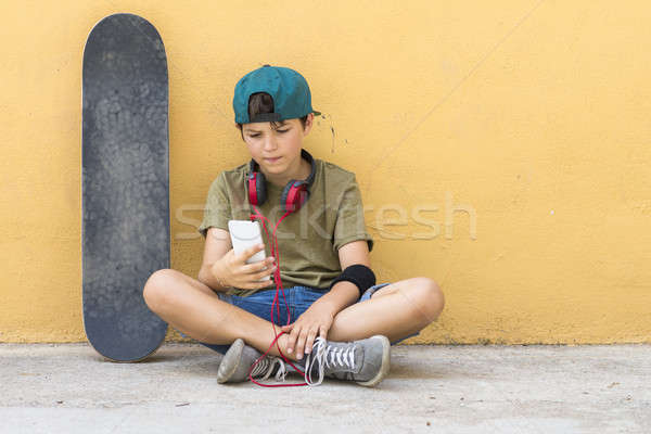 Portrait of a teenager sitting on the floor on a street road cha Stock photo © 2Design
