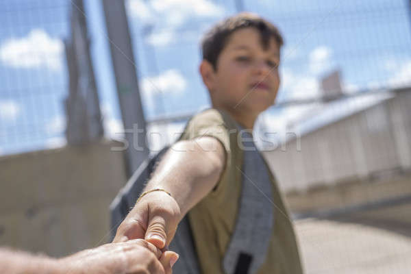 Cheerful child carrying his backpack standing in front of the sc Stock photo © 2Design