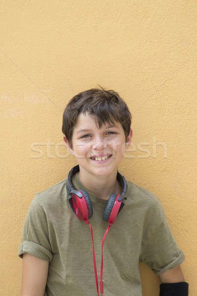 Sorridente adolescente menino posando ao ar livre olhando Foto stock © 2Design