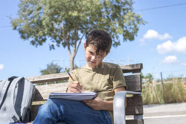 Portre genç erkek oturma ödev ahşap Stok fotoğraf © 2Design