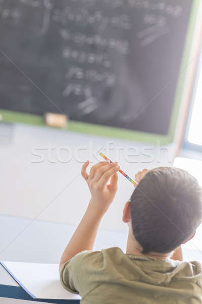 Student attending in a  classroom during a lesson Stock photo © 2Design