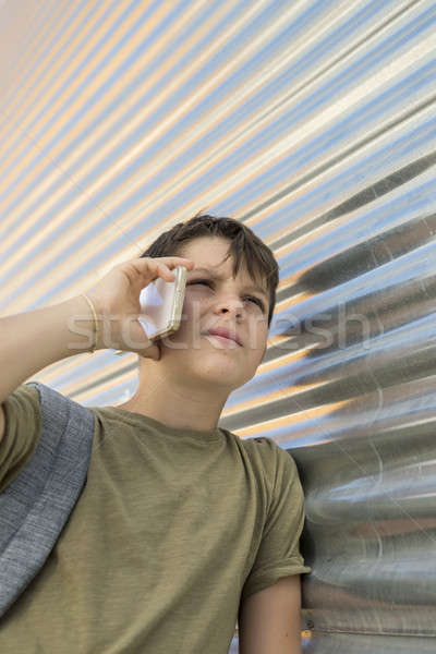 Cheerful boy using a mobile phone Stock photo © 2Design