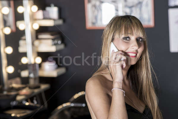 Portrait of a young and pretty hairdresser with phone Stock photo © 2Design