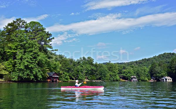 Stock photo: Woman Kayaking Close to Shore