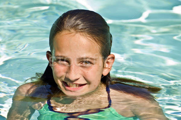 Preteen Girl in a Pool Stock photo © 2tun