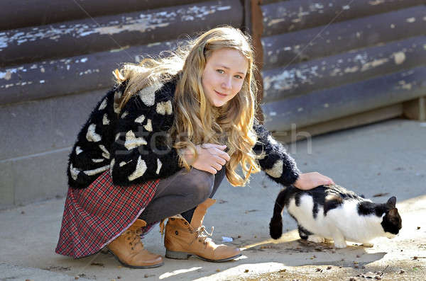 Stock photo: Girl and Barn Cat