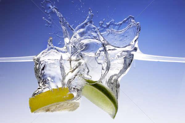 Csobbanás citrom citrus közelkép lövés gyümölcs Stock fotó © 350jb