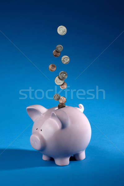 Coins dropping into a piggy bank Stock photo © 350jb