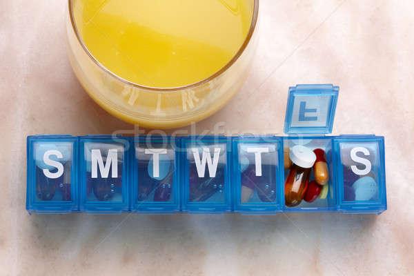апельсиновый сок ежедневно наркотиков организатор синий пластиковых Сток-фото © 350jb