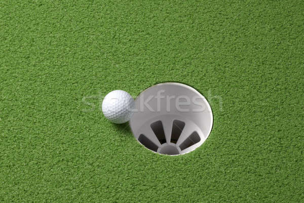 Golf ball rolls to hole Stock photo © 350jb