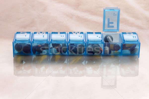 таблетки капсула ежедневно синий пластиковых организатор Сток-фото © 350jb