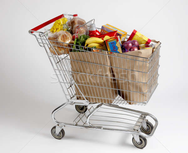 Shopping cart filled with groceries Stock photo © 350jb