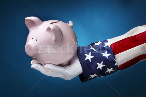 Uncle Sam holding piggy bank Stock photo © 350jb