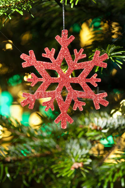 Red artificial snow flake in a christmas tree Stock photo © 3523studio