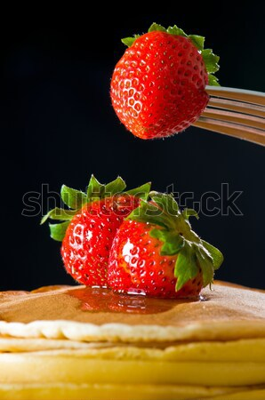 Strawberry butter pancake with honey/ maple sirup flowing down Stock photo © 3523studio