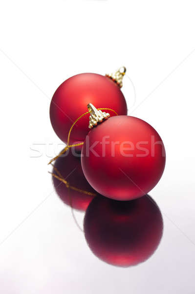 Christmas baubles on a silver reflective surface Stock photo © 3523studio