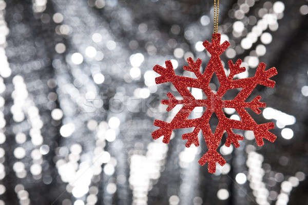 Stock photo: Red snow flake on a silver glitter background