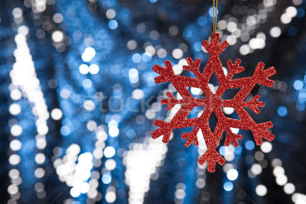 Stock photo: Red snow flake on a blue, silver glitter background
