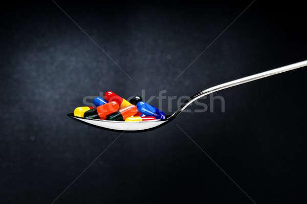 Uno cucchiaio pillole salute Foto d'archivio © 3523studio