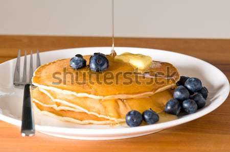 blueberry pancakes on a plate with fork Stock photo © 3523studio